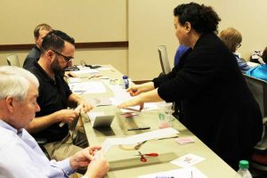 Miriam Centeno, Collections Care Coordinator, leads a hands-on exhibits workshop