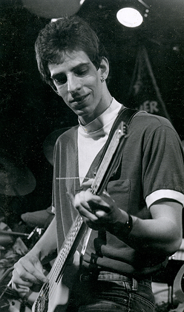 Mark Rubel performing on his Steinberger electric bass, 1982.