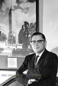 Photo of Nathan M. Newmark next to a picture of the Latino-Americana Tower in Mexico City (ca. 1965). Found in Record Series 26/4/1.